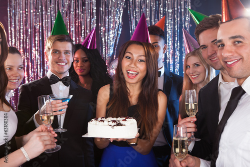 Woman Celebrating Birthday With Friends At Nightclub