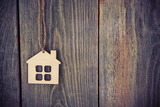 house as symbol on wooden background