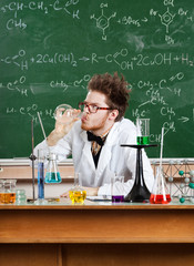 Mad professor drinks the liquid in the vial in his laboratory