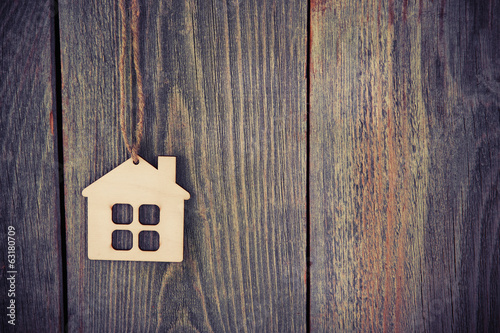 canvas print picture house as symbol on wooden background