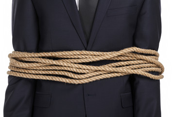 Close up of businessman tied with the rope, isolated on white