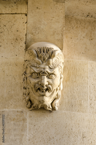 Gargoyle head on the pont neuf
