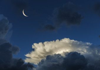 Beautiful clouds and crescent moon in the early morning