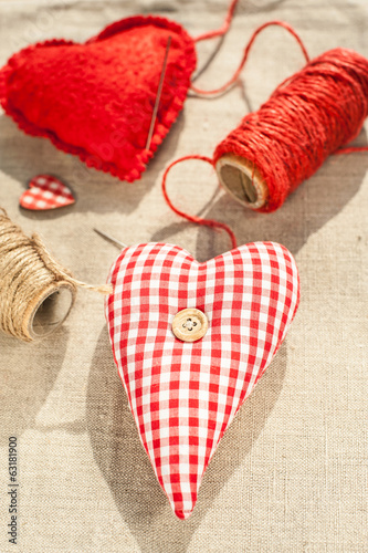 Two homemade sewed red cotton love hearts