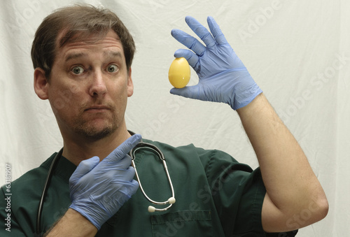 Doctor in Scrubs holding Easter Egg
