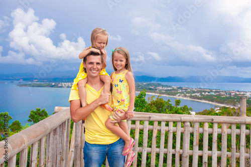 Smiling family at observation deck on the background of