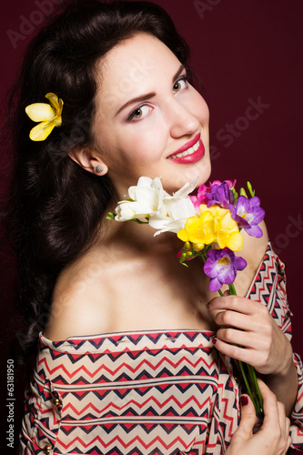 studio portrait of a girl with pink flowers