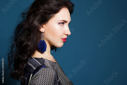 Brunette lady with feather earring