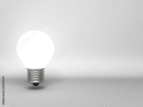 Idea concept, single light bulb on gray background