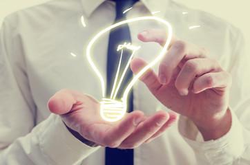 Businessman with creative light bulb icon