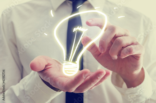 Businessman with creative light bulb icon