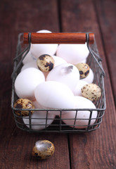 basket of chicken and quail eggs