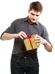 Holiday. Man got golden gift box with red ribbon