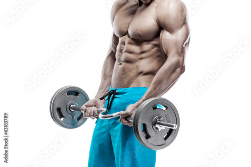 Muscular bodybuilder guy doing exercises with dumbbells over whi - 63183789