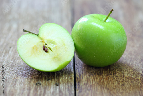 green apple fruit on wood background