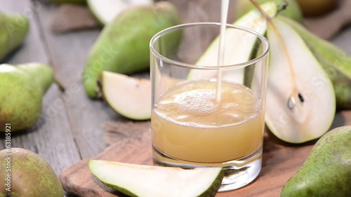 Filling Pear Juice in a glass