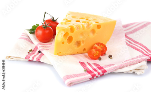 Piece of cheese and tomatoes,on color napkin, isolated on white