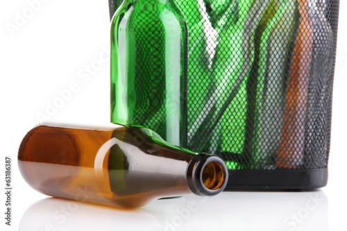 Glass bottles in recycling bin close up