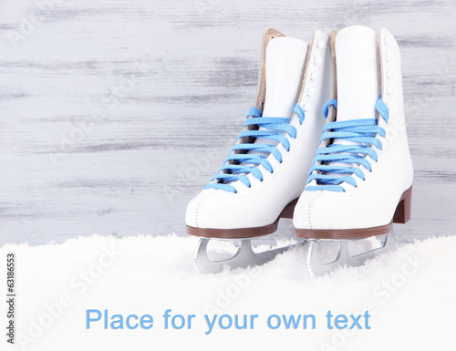 canvas print picture Figure skates on wooden background