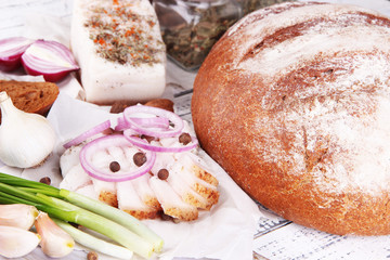 Rye bread with lard and onion on table close up