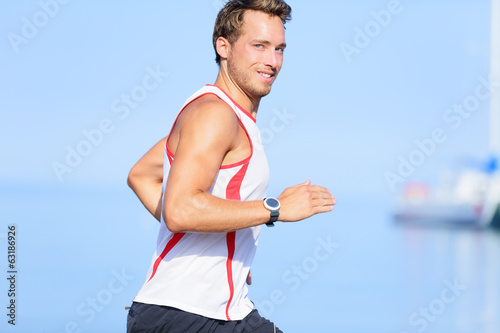Running man runner looking at camera smiling
