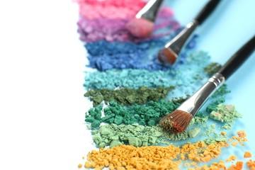 Rainbow crushed eyeshadow and professional make-up brush close