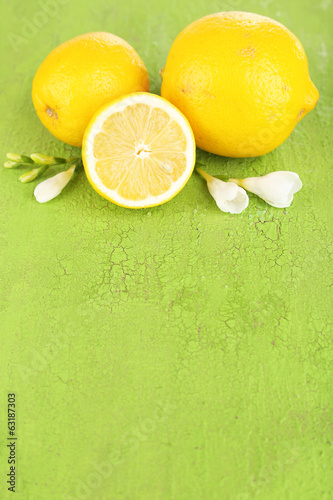 Fresh lemons and lavender on green table