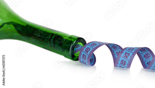 Wine bottle and measuring tape isolated on white