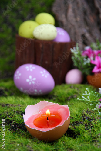 Conceptual Easter composition. Burning candle in egg, Easter