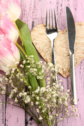 Table place setting with decorations on color wooden background