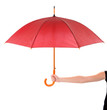 Red Umbrella in hand isolated on white