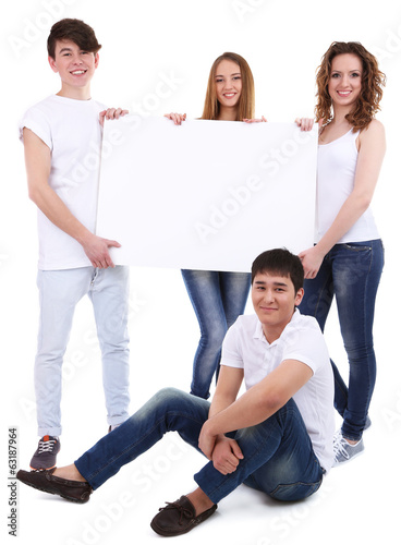 Group of happy young people holding blank poster isolated