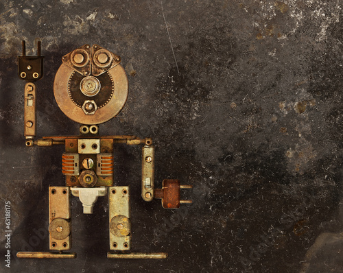 Robot of the metal parts on a dark grungy background