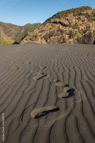 footprints in volcanic sand
