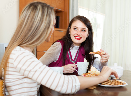 women drinking tea and gossiping