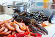 Fresh lobster and other seafood  in home kitchen