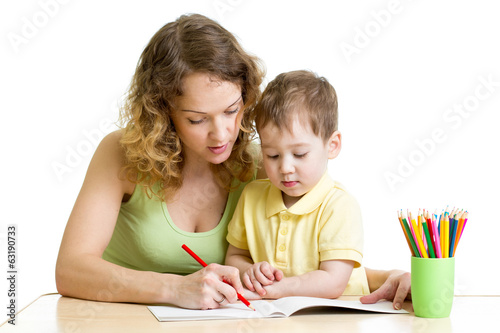 kid boy and mother draw with colorful pencils
