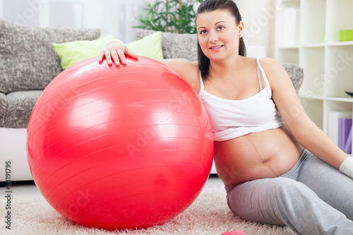 Pregnant woman resting leaned on a gymnastic ball