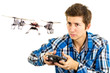 canvas print picture - man playing with a quadcopter drone