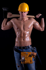 young muscular worker holding hatchet