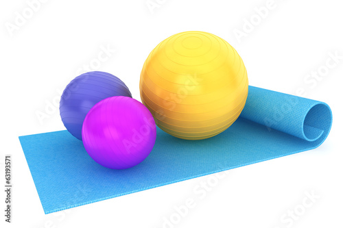 Exercise mat with colorful fitness balls