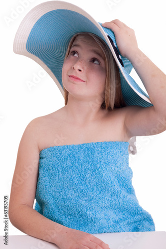 Beautiful little girl in blue summer hat