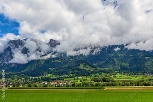 Green field and mountains in Germany.