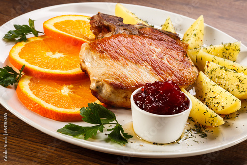 Grilled steak, boiled potatoes and lingonberry jam
