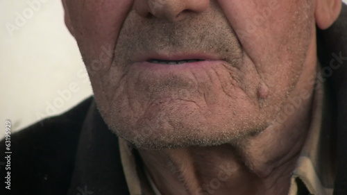 Old man smoking cigarette - mouth close up