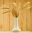 image of a beautiful vase with wheat on the table