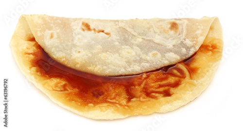 Handmade roti bread with molasses