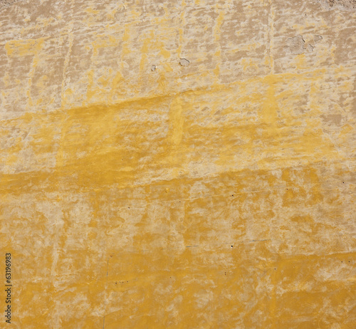 old plaster with interesting pattern with yellow color