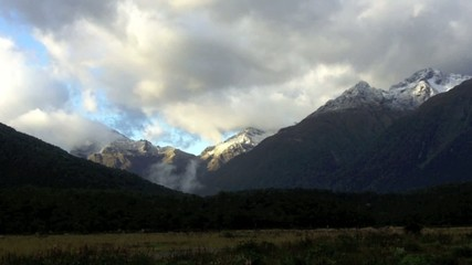 Landscape of mountains with snow in Fiordland, New Zealand.