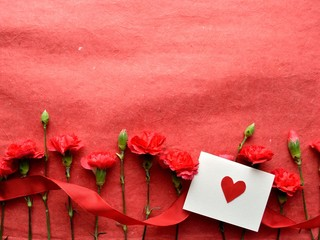 Heart message card and red carnations